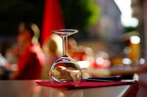 clear wine glass on top of brown table