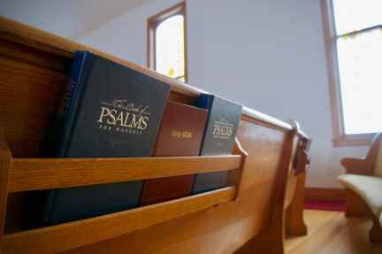 three bibles on wooden bench