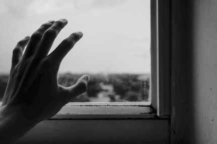 close up photography of hand near window